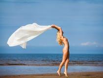 Nude woman on the beach Stock Photo