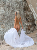 Nude woman on the beach with white cloth Royalty Free Stock Photography