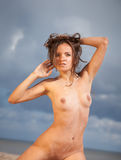 Nude woman on the beach Stock Image