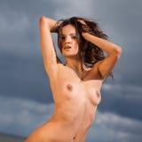 Nude woman on the beach Stock Photos