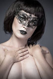 Nude woman, beautiful young in a black  mask Royalty Free Stock Image