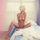 Nude woman in bed Royalty Free Stock Photography