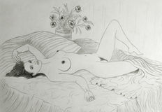 Nude woman on bed Stock Image
