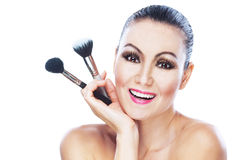 Nude woman brushes hand Stock Images