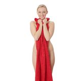 Nude woman covered by red towel Royalty Free Stock Photography