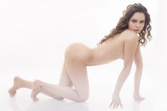 Nude woman crawling on floor. Royalty Free Stock Photo