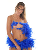 Nude woman with feather boa. Three quarter body portrait of sexy young nude woman wrapped in blue feather boa, white background Stock Image