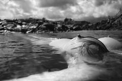 Nude woman floating in sea. Royalty Free Stock Photography