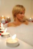 Nude woman in foamy bath Royalty Free Stock Photos