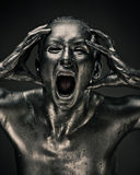Nude woman like statue in liquid metal Stock Photo