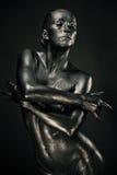 Nude woman like statue in liquid metal Royalty Free Stock Image