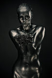 Nude woman like statue in liquid metal Royalty Free Stock Image