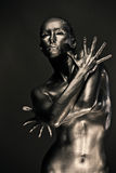 Nude woman like statue in liquid metal Royalty Free Stock Photos