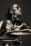 Nude woman like statue in liquid metal Stock Images