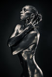Nude woman like statue in liquid metal Stock Image