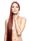 Nude woman with long red hair Stock Images