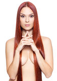 Nude woman with long red hair Stock Photography