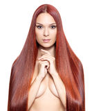 Nude woman with long red hair Royalty Free Stock Image