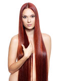 Nude woman with long red hair Royalty Free Stock Images