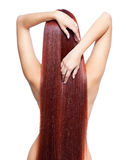 Nude woman with long red hair Stock Photo