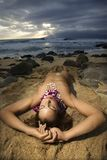 Nude woman lying on beach. Royalty Free Stock Images