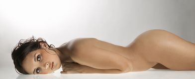 Nude woman lying down. Royalty Free Stock Photos