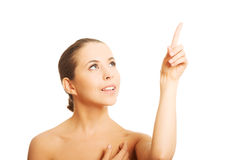 Nude woman pointing up Stock Photos