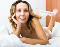 Nude woman posing on bed Royalty Free Stock Photo