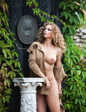 Nude woman posing near the old country house Royalty Free Stock Photography
