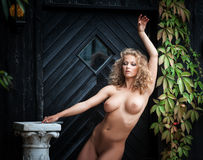 Nude woman posing near the old country house Stock Photo