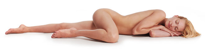 Nude woman relaxing on the floor eyes closed Stock Photography