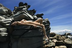 Nude woman on rocks. Stock Photography