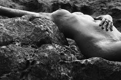 Nude woman on rocks. Royalty Free Stock Photos