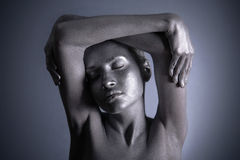Nude woman with silver make-up. Elegant body-art. Nude woman with silver make-up Stock Images