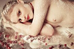 Nude woman in snow Royalty Free Stock Image