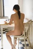 Nude woman typing. Stock Image