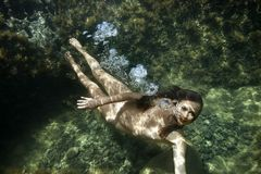 Nude woman underwater. Royalty Free Stock Images
