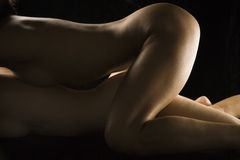 Nude women lying together. Stock Images
