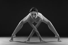 Nude yoga. Beautiful sexy body of young woman on black background Royalty Free Stock Photos