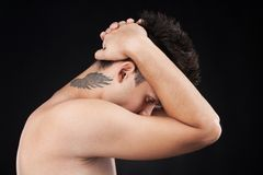Nude young man with tattoo on neck. stock image