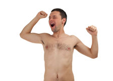 Nude young man yawning and stretching Stock Photos