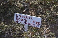 Nudist beach direction. Sign at Crete, Greece stock images