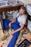 Nudna praca repairman Zdjęcia Stock