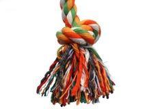 Nudo colorido de la cuerda con la borla fotografía de archivo libre de regalías