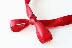 Nudo rojo de la cinta Foto de archivo libre de regalías