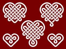 Nudos chinos en la forma de corazón Fotos de archivo libres de regalías