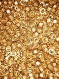 Nueces de cobre, fondo del cobre del tornillo de la nuez foto de archivo libre de regalías