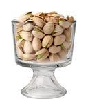 Nueces de pistacho en un vidrio del postre Fotografía de archivo