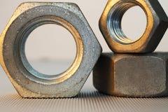 Nueces del metal macras Fotos de archivo libres de regalías