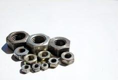 Nueces del tornillo del hierro Fotografía de archivo libre de regalías